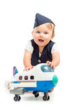 Baby girl dressed as  stewardess with airplane toy Stock Photography