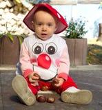 Baby girl dressed like a mushroom Stock Photo