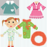 Baby Girl with dresses, overall and hood Stock Image