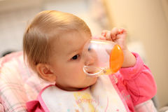 Baby girl drinking Royalty Free Stock Photo