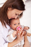 Baby girl drinking from bottle Stock Photography