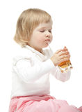The baby girl is drinking juice Royalty Free Stock Photography
