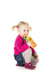 Baby girl drinking tea Stock Images