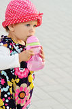 Baby girl drinking water Royalty Free Stock Images