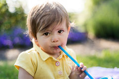 Baby girl drinking water Royalty Free Stock Photo