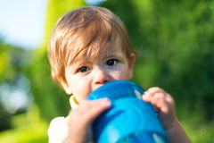 Baby girl drinking water royalty free stock photos