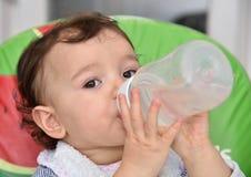 Baby girl drinking water Stock Photo