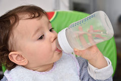 Baby girl drinking water Royalty Free Stock Photography