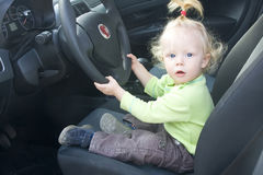 Baby girl driving Stock Photo