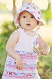 Baby girl with dry leaf Stock Images