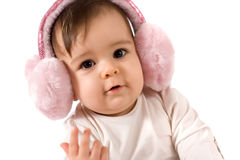 Baby girl with ear warmer. Adorable baby girl with ear warmer, studio shot royalty free stock photo