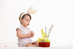 Baby girl with easter basket Stock Photos