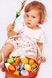 Baby girl and easter basket with eggs Stock Images