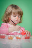 Baby girl and Easter eggs Stock Image