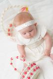 Baby Girl at Easter. Baby Girl in White Easter Dress with Basket Royalty Free Stock Image