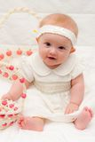 Baby Girl at Easter. Baby Girl in White Easter Dress with Basket Stock Photography