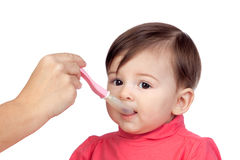 Baby girl eating Royalty Free Stock Image