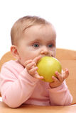 Baby girl eating Royalty Free Stock Photos