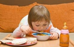 Baby girl eating Stock Photography