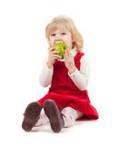 Baby girl eating apple Royalty Free Stock Image
