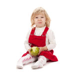 Baby girl eating apple Stock Images