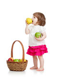 Baby girl eating apples Stock Photo