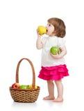 Baby girl eating apples Stock Photo