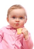 Baby girl  eating bread Royalty Free Stock Image