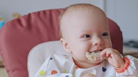 A Baby Girl Eating Bread at Home stock video