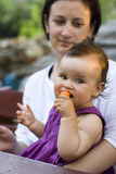 Baby girl eating a carrot Royalty Free Stock Photos