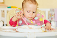 Baby girl is eating Royalty Free Stock Photo