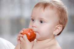 Baby girl eating healthy food Stock Image