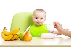 Baby girl eating healthy food Stock Photography