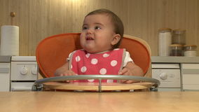 Baby girl eating stock video footage