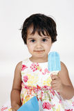 Baby girl eating ice cream Royalty Free Stock Photos
