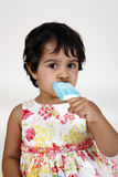 Baby girl eating ice cream Stock Photography