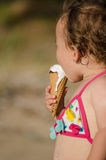 Baby girl eating ice-cream Royalty Free Stock Image