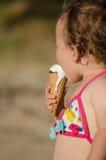 Baby girl eating ice-cream Royalty Free Stock Image