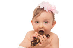 Baby girl eating stock photos