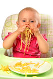 Baby girl eating pasta Royalty Free Stock Photo