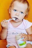 Baby girl eating puree Stock Photography