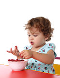 Baby girl eating raspberry Stock Image