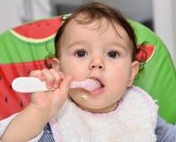 Baby girl eating Royalty Free Stock Photos