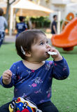 Baby Girl eating a snack Stock Photo