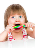 Baby girl eating a sticky lollipop Royalty Free Stock Photo