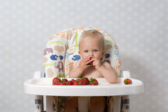 Baby girl eating strawberries Royalty Free Stock Photography