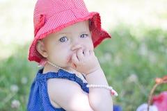 Baby girl is eating strawberrt Stock Images