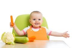 Baby girl eating vegetables Stock Image