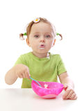 Baby girl eating yoghurt Royalty Free Stock Images