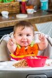 Baby Girl Eats Breakfast Stock Image